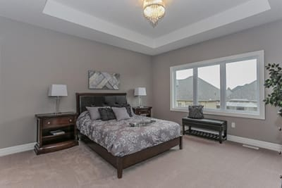 Stonebridge - master bedroom with bed in view - new community homes for sale